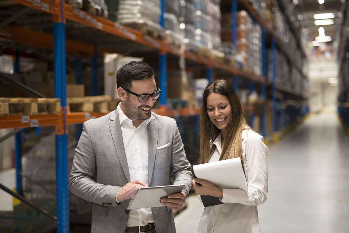 Two people speaking in a fulfillment center