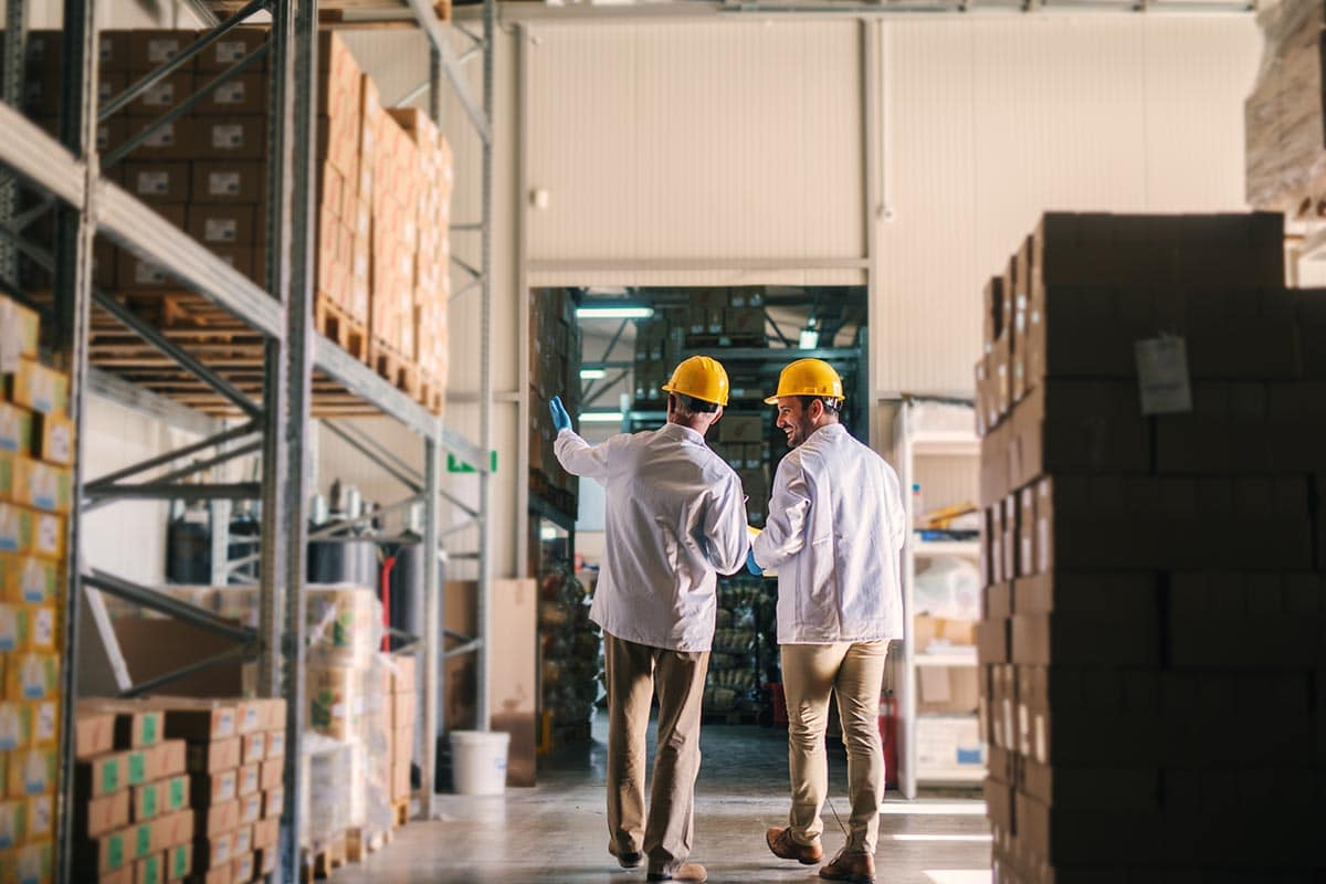 Third-party logistics company workers amid boxes and shelves