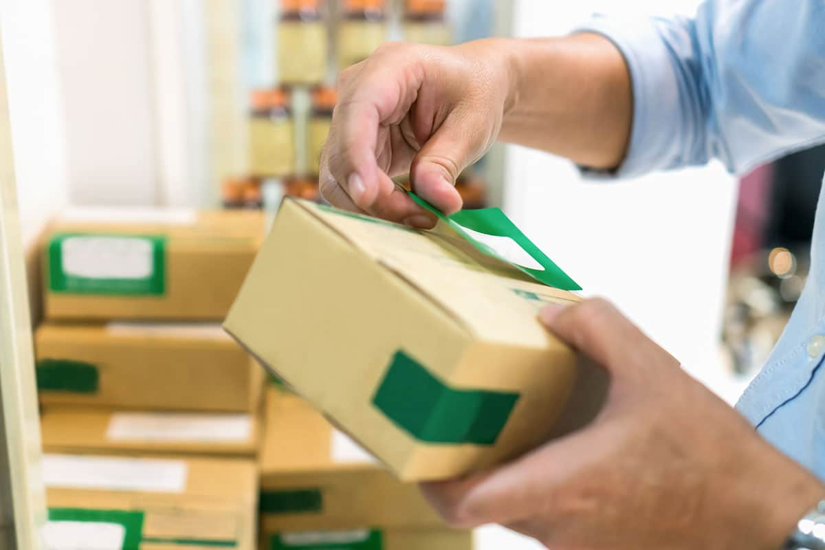 Employees are packing a parcel in the send to the customer
